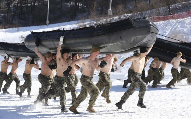 South Korean Marines and U.S. Marines from the 3rd Division Expeditionary Forces carry inflatable boats during a combined military winter exercise in Pyeongchang, South Korea, Tuesday, Jan. 24, 2017. Marines from South Korea and U.S. are participating in the four-week winter combined exercise in South Korea. (AP Photo/Lee Jin-man)
