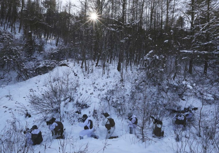 South Korean Marines and U.S. Marines from the 3rd Division Expeditionary Forces demonstrate a reconnaissance mission during a combined military winter exercise in Pyeongchang, South Korea, Tuesday, Jan. 24, 2017. Marines from South Korea and U.S. are participating in the four-week winter combined exercise in South Korea. (AP Photo/Lee Jin-man)