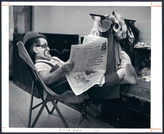 Performer with Ringling Brothers reads the newspapers in 1966. (Baltimore Sun)
