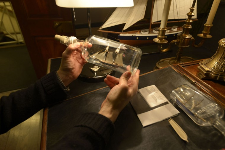 In addition to working as a guide at the hotel, historian Steven Foote makes model ships in bottles, a nod to Fells Point's history as a shipbuilding center. (Christina Tkacik/Baltimore Sun)
