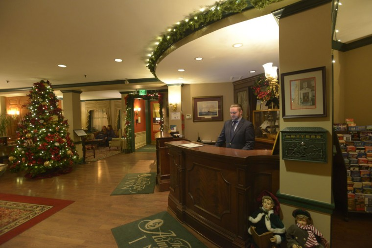 The lobby in the Admiral Fell, formerly known as the Anchorage. The front desk sometimes fields calls from guests who report parties happening in the room nextdoor -- parties that mysteriously go silent once the phonecall is placed. (Christina Tkacik/Baltimore Sun)