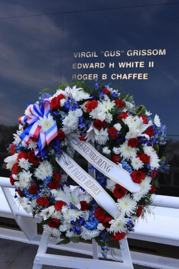 Family members of fallen astronauts placed a wreath at the Space Mirror Memorial at the Kennedy Space Center's NASA Day of Remembrance ceremony on Thursday.The monument includes the names of the fallen astronauts from Apollo 1, Challenger and Columbia, as well as the astronauts who perished in training and commercial airplane accidents are emblazoned on the monument's 45-foot-high-by-50-foot-wide polished black granite surface. (NASA handout photo)
