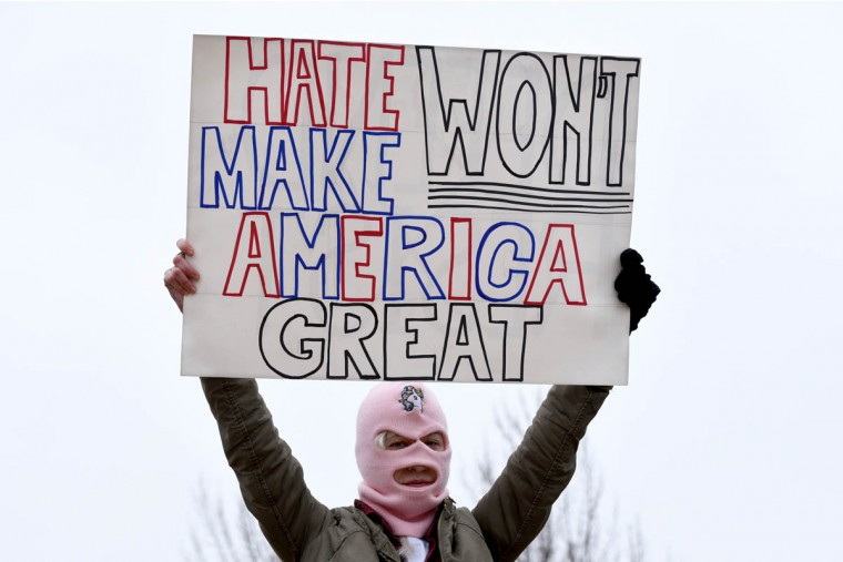 "Krissy Wesolowski, of Baltimore, held a sign that said, ""Hate won't make America Great"" at the Women's March on Washington. She added, ""The reason Trump is in office is because he really used hate to fuel people's fears."" (Amy Davis/Baltimore Sun)"