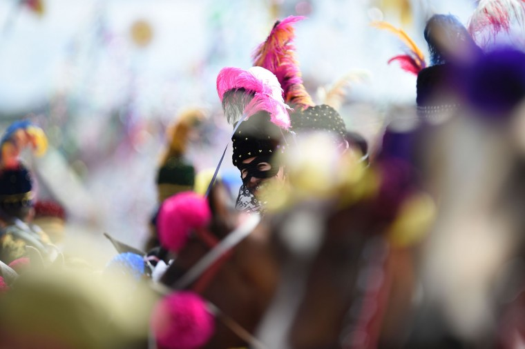 Revellers participate in the traditional carnival on horseback in Bonfim, Minas Gerais state, southeastern Brazil, on February 27, 2017. Dressed in hand-embroidered velvet costumes, mounted on beautiful horses, people ride through the town with confetti and streamers in a tradition that dates back to the 18th century, turning the war between the Moors and Christians into a religious festival. (Douglas Magno/AFP/Getty Images)