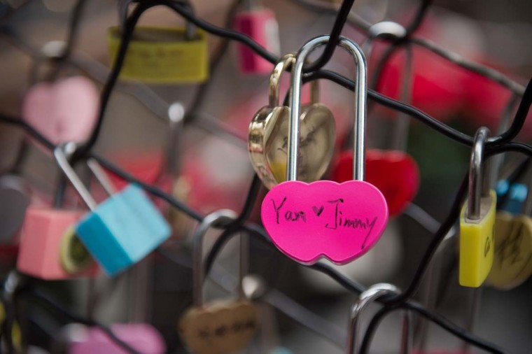 "A love lock attached by a couple a few minutes before, reads ""Yan love Jimmy"" at a shopping mall on Valentine's Day in Beijing on February 14, 2017. (NICOLAS ASFOURI/AFP/Getty Images)"