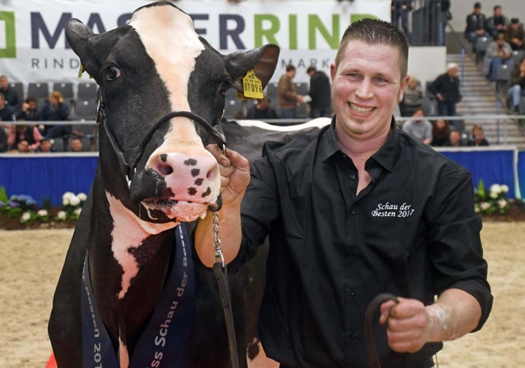 "Farmer Henrik Wille smiles as he presents his cow ""Madame"" after she won the ""Schau der Besten"" (Show of the Best) dairy cow beauty pageant on February 23, 2017 in Verden an der Aller, northwestern Germany. (CARMEN JASPERSEN/AFP/Getty Images)"