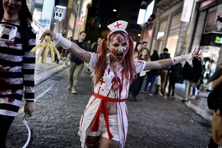 "Revelers participate in a ""Zombie walk"" parade celebrating the carnival season in Athens, on February 25, 2017. (LOUISA GOULIAMAKI/AFP/Getty Images)"