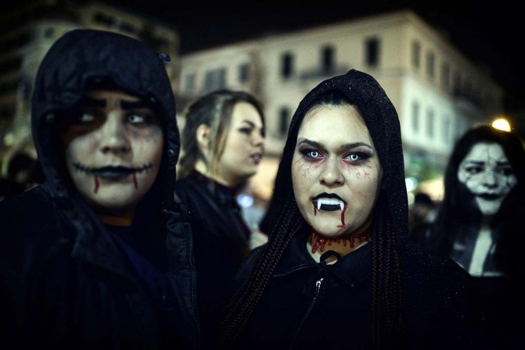 People take part in the Zombie Walk during carnival celebrations in the Greek capital Athens on February 25, 2017. (LOUISA GOULIAMAKI/AFP/Getty Images)