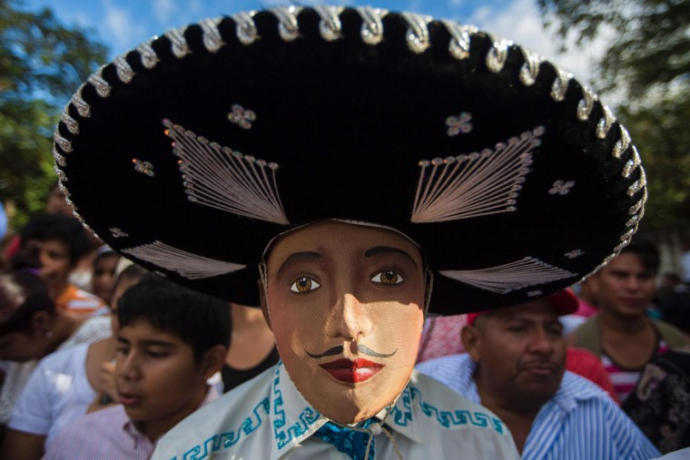 "Man dressed as a traditional character in the ""Baile de Negras"" dance takes part in the celebration of the feast day of the Virgin of the Candelaria (Candlemas) in the town of Diriomo, some 45 km from Managua, Nicaragua on February 2, 2017. Candlemas falls forty days after Christmas and is celebrated by Catholics as the presentation of Christ at the Temple. (AFP Photo/Inti Ocon)"