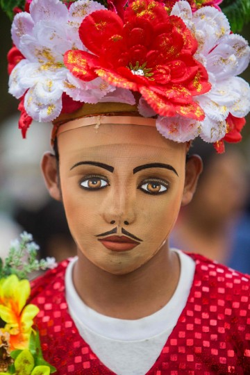 "A woman dressed as a traditional character in the ""Baile de Negras"" dance poses for a picture on the feast day of the Virgin of the Candelaria (Candlemas) in the town of Diriomo, some 45 km from Managua, Nicaragua on February 2, 2017. Candlemas falls forty days after Christmas and is celebrated by Catholics as the presentation of Christ at the Temple. (AFP Photo/Inti Ocon)"