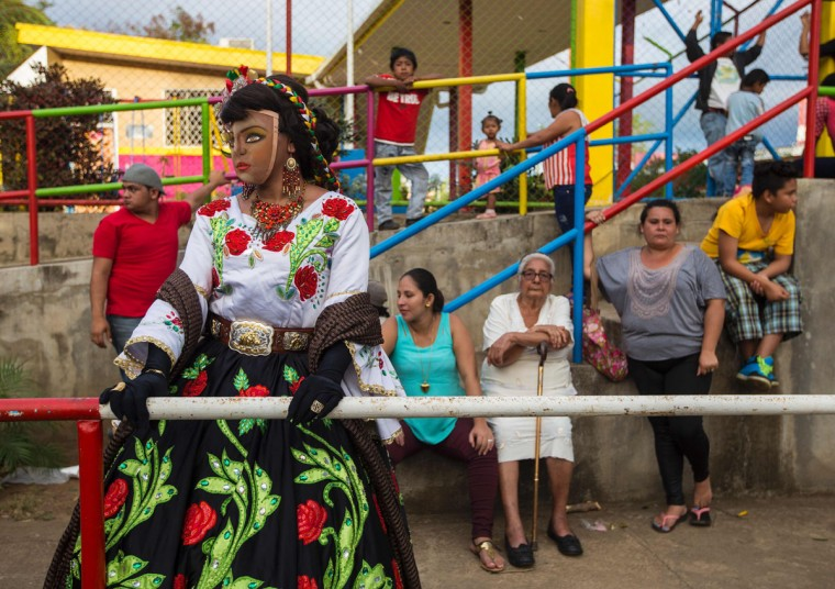 "A woman dressed as a traditional character in the ""Baile de Negras"" gets ready to dance on the feast day of the Virgin of the Candelaria (Candlemas) in the town of Diriomo, some 45 km from Managua, Nicaragua on February 2, 2017. Candlemas falls forty days after Christmas and is celebrated by Catholics as the presentation of Christ at the Temple. (AFP Photo/Inti Ocon)"