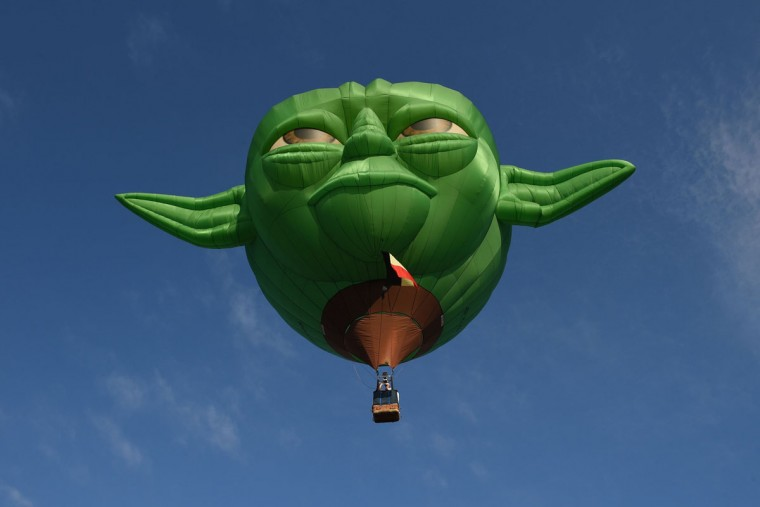 A hot air ballon in the likeness of Star Wars film character Yoda takes flight during the annual International Hot Air Balloon Festival at the former Clark US Air Force base in Pampanga province, north of Manila on February 9, 2017. Some 29 balloon enthusiasts from around the globe are participating in the event which runs February 9 to 12. (TED ALJIBE/AFP/Getty Images)