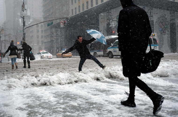 People make their way during a winter storm in New York on February 9, 2017. A heavy winter snow storm lashed the northeastern United States Thursday, subjecting New York to near blizzard-like conditions and forcing flight cancellations as schools and the United Nations closed. (Jewel Samad/AFP/Getty Images)