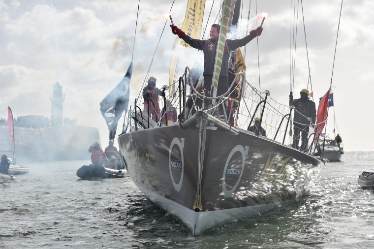 """French skipper Romain Attanasio, placing 15th in the Vendee Globe around-the-world solo sailing race, celebrates aboard his Imoca 60 monohull """"Famille Mary-Etamine du Lys"""" on February 24, 2017 as he arrives in Les Sables-d'Olonne, western France. (Jean-Sebastien Evrard/AFP/Getty Images)"""
