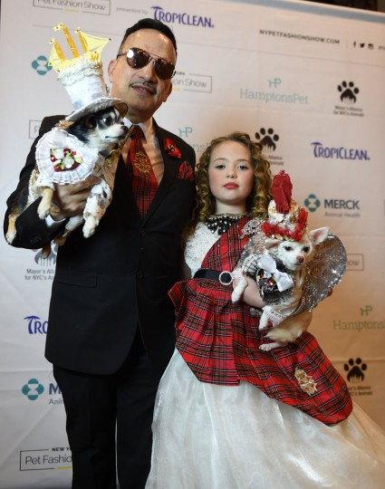 Anthony Rubio and Bridilla, representing England and contestants in the World Fashion Presents segment, during the 14th Annual New York Pet Fashion Show presented by TropiClean at the Hotel Pennsylvania February 9, 2017. (TIMOTHY A. CLARY/AFP/Getty Images)