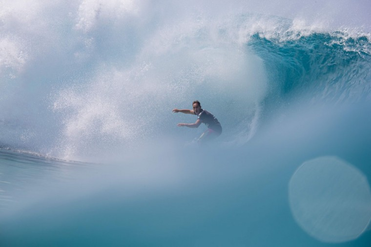Hawaiian surfer Makua Kai Rothman surfs a perfect barrel during the 2017 Volcom Pipe pro at Pipeline February 4, 2017, on the North shore of Oahu Island in Hawaii. (AFP PHOTO / brian bielmann)