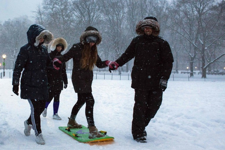 People pay under a snowfall in Central Park during a winter storm on January 7, 2017 in New York. (Eduardo Munoz Alvarez/AFP/Getty Images)