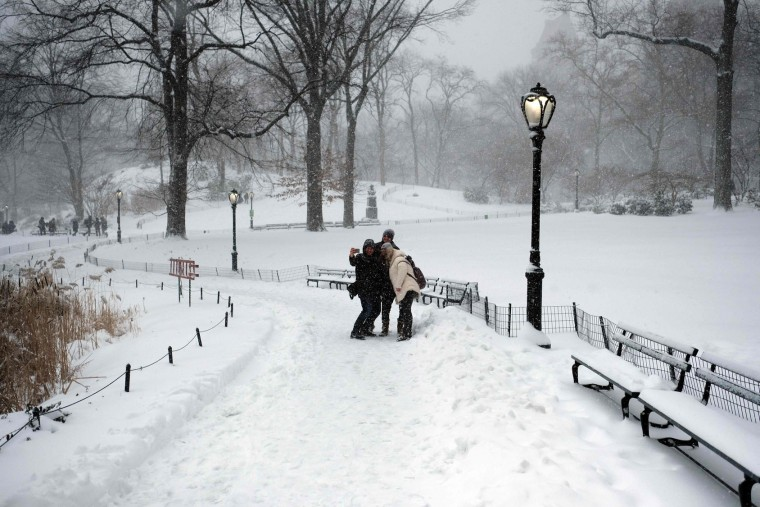 Tourists take pictures at the snow-covered Central Park during a winter storm in New York on February 9, 2017. A heavy winter snow storm lashed the northeastern United States Thursday, subjecting New York to near blizzard-like conditions and forcing flight cancellations as schools and the United Nations closed. (Jewel Samad/AFP/Getty Images)