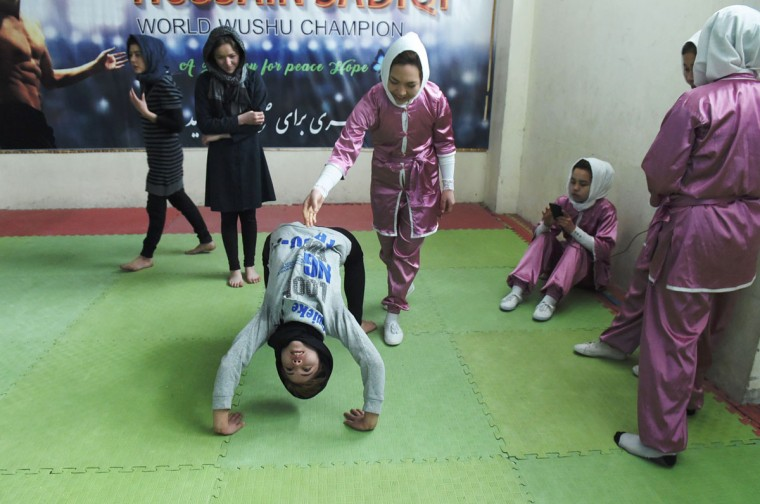 In this photograph taken on January 21, 2017, Afghan members of a wushu martial arts group take part in a traning session in Kabul. Afghanistan's first female wushu trainer, Sima Azimi, 20, is training 20 Afghan girls aged between 14 - 20 at a wushu club in Kabul, after learning the sport while living as a refugee in Iran. (WAKIL KOHSAR/AFP/Getty Images)