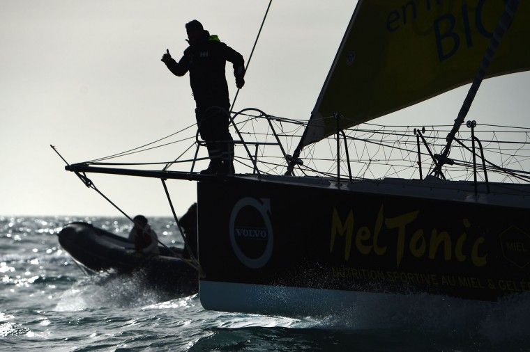 "French skipper Romain Attanasio, placing 15th in the Vendee Globe around-the-world solo sailing race, celebrates aboard his Imoca 60 monohull ""Famille Mary-Etamine du Lys"" on February 24, 2017 as he arrives in Les Sables-d'Olonne, western France. (Jean-Sebastien Evrard/AFP/Getty Images)"