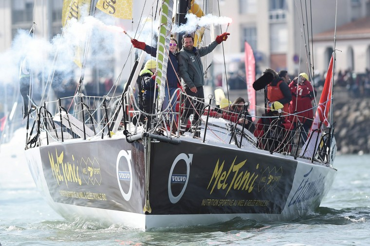 "French skipper Romain Attanasio, placing 15th in the Vendee Globe around-the-world solo sailing race, celebrates with his wife Samantha Davies aboard his Imoca 60 monohull ""Famille Mary-Etamine du Lys"" on February 24, 2017 as he arrives in Les Sables-d'Olonne, western France. (Jean-Sebastien Evrard/AFP/Getty Images)"