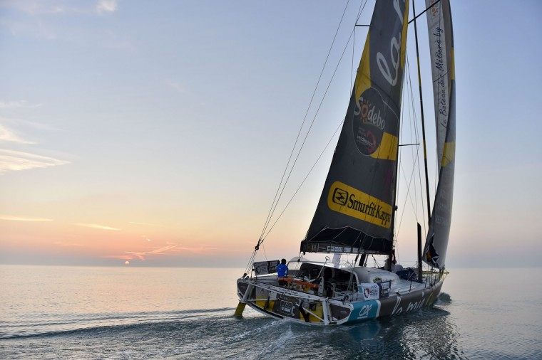 """French skipper Arnaud Boissieres, also known as 'Cali', arrives 10th aboard of his Imoca 60 monohull """"La Mie Caline"""", after his third Vendee Globe around-the-world solo sailing race, on February 17, 2017 off Les Sables-d'Olonne, western France. (Loic Venance/AFP/Getty Images)"""