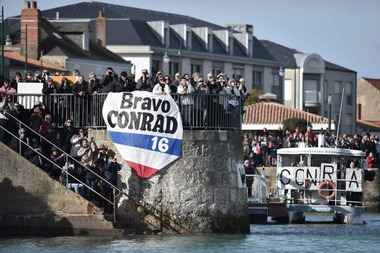 Supporters of New Zealand's skipper Conrad Colman hold a banner upon his arrival in Les Sables-d'Olonne, western France, at the end of the Vendee Globe around-the-world solo sailing race on February 24, 2017. Colman finished 16th. (Jean-Sebastien Evrard/AFP/Getty Images)