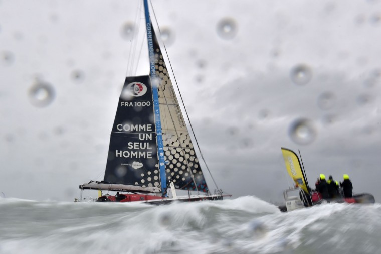 """French skipper Eric Bellion arrives aboard his Imoca 60 """"Comme un seul Homme"""" as he arrives at Les Sables d'Olonne after placing 9th of the Vendee Globe solo around-the-world sailing race on February 13, 2017. (Loic Venance/AFP/Getty Images)"""