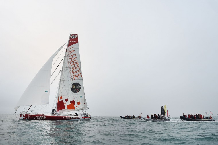 """Swiss skipper Alan Roura, placing 12th in his first participation to the Vendee Globe around-the-world solo sailing race, arrives aboard his Imoca 60 monohull """"La Fabrique"""" on February 20, 2017 in Les Sables-d'Olonne, western France. (Jean-Sebastien Evrard/AFP/Getty Images)"""