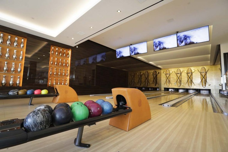 This Thursday, Jan. 26, 2017, photo shows the four-lane bowling alley at a $250 million mansion in the Bel-Air area of Los Angeles. At $250 million, the new mansion in the exclusive Bel-Air neighborhood of Los Angeles is the most expensive home listed in the U.S. (AP Photo/Jae C. Hong)