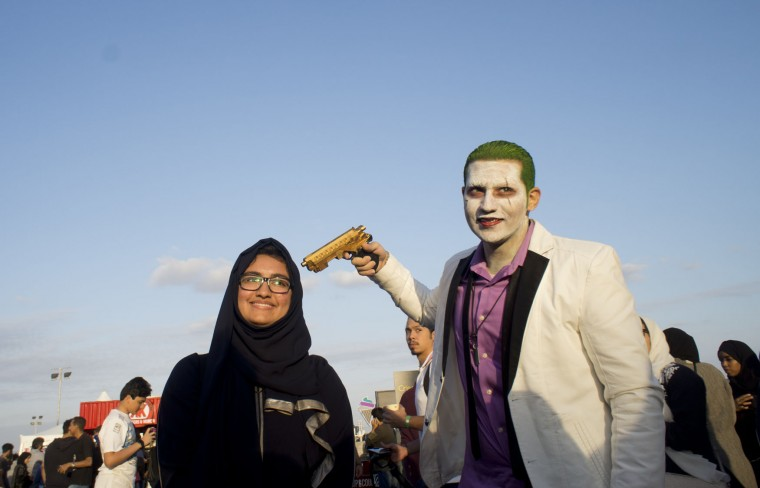 A visitor poses for picture with a man disguised as The Joker, during the Saudi Comic Con (SCC) which is the first event of its kind to be held in Jiddah, Saudi Arabia, Friday, Feb. 17, 2017. (AP Photo)