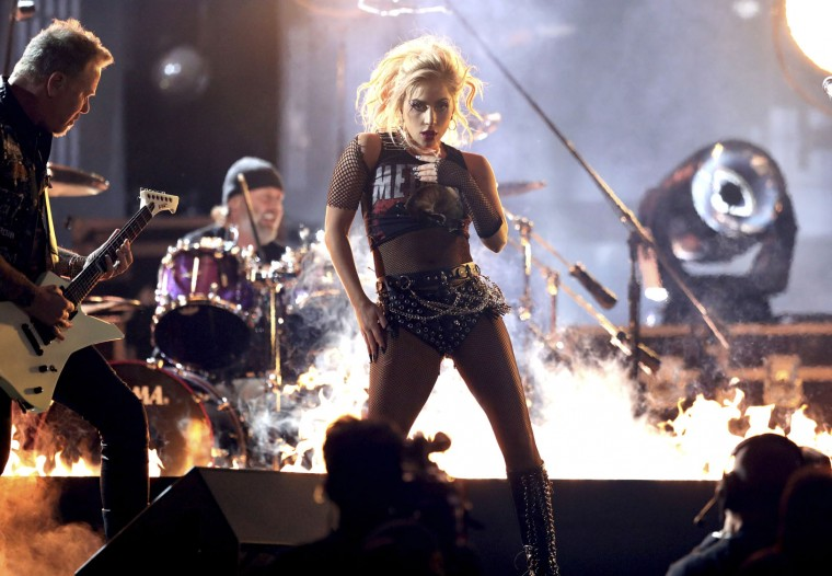 """Lady Gaga, right, and James Hetfield of """"Metallica,"""" left, perform """"Moth Into Flame"""" at the 59th annual Grammy Awards on Sunday, Feb. 12, 2017, in Los Angeles. (Photo by Matt Sayles/Invision/AP)"""