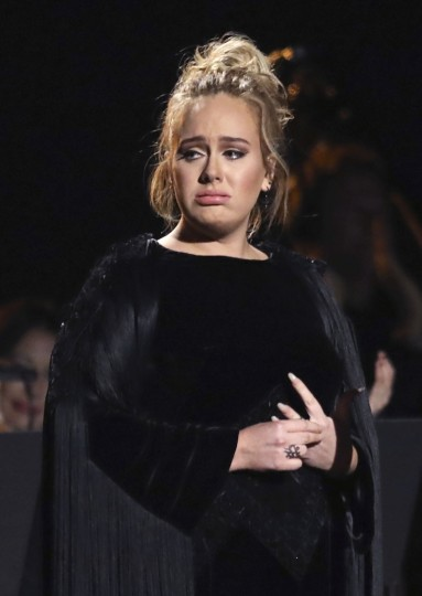 Adele reacts after concluding a performance tribute to George Michael at the 59th annual Grammy Awards on Sunday, Feb. 12, 2017, in Los Angeles. (Photo by Matt Sayles/Invision/AP)