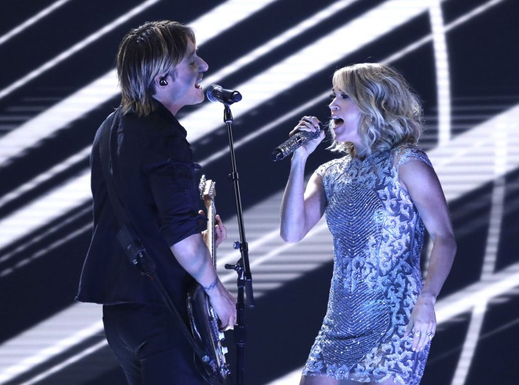 """Keith Urban, left, and Carrie Underwood perform """"The Fighter"""" at the 59th annual Grammy Awards on Sunday, Feb. 12, 2017, in Los Angeles. (Photo by Matt Sayles/Invision/AP)"""