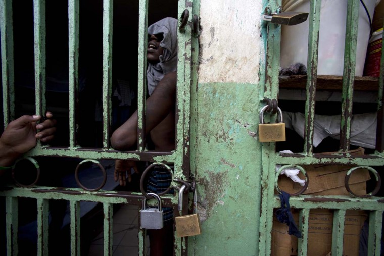 In this Feb. 13, 2017 photo, an ailing prisoner stands in a cell designated for sick prisoners near the infirmary in the National Penitentiary in downtown Port-au-Prince, Haiti. Prison authorities say they try their best to meet inmates' needs, but repeatedly receive insufficient funds from the state to buy food and cooking fuel, leading to deadly cases of malnutrition-related ailments such as beriberi and anemia. (AP Photo/Dieu Nalio Chery)