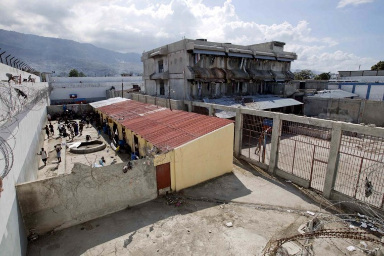 This Feb. 13, 2017 photo shows prisoners in a courtyard at the National Penitentiary in downtown Port-au-Prince, Haiti. Haiti's penal system is by far the globe's most congested, with a staggering 454 percent occupancy level, according to the most recent ranking by the University of London's Institute for Criminal Policy Research. (AP Photo/Dieu Nalio Chery)