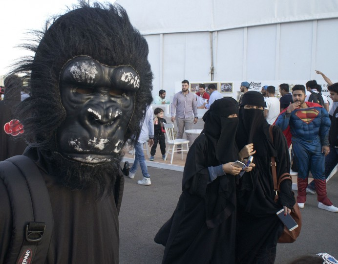 Visitors wear masks during the Saudi Comic Con (SCC) which is the first event of its kind to be held in Jiddah, Saudi Arabia, Thursday, Feb. 16, 2017. (AP Photo)