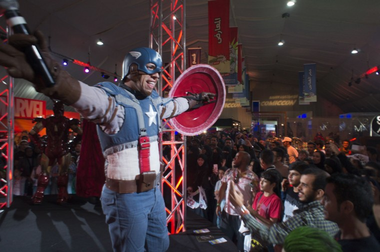A man wears a Captain America costume representing a fictional superhero appearing in American comic books published by Marvel Comics, during the Saudi Comic Con (SCC) which is the first event of its kind to be held in Jiddah, Saudi Arabia, Friday, Feb. 17, 2017. (AP Photo)