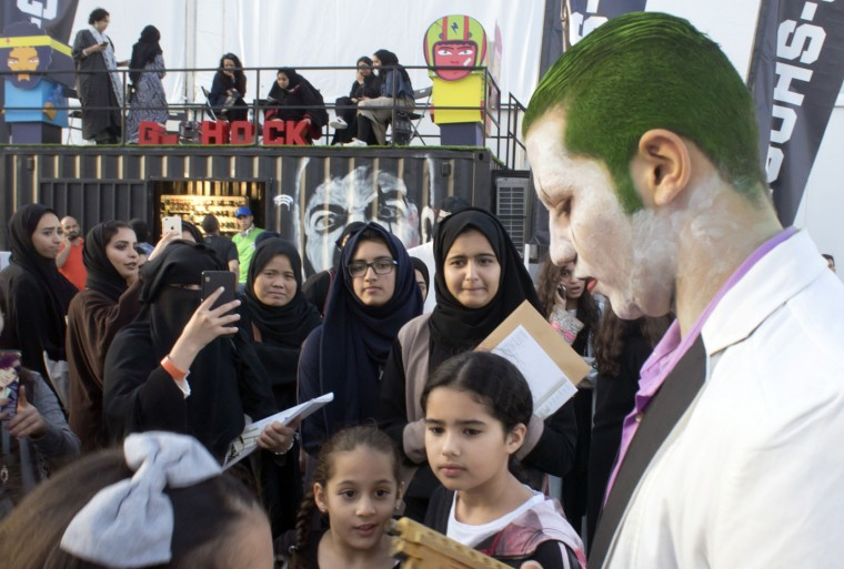 Visitors take pictures for a man disguised as The Joker, during the Saudi Comic Con (SCC) which is the first event of its kind to be held in Jiddah, Saudi Arabia, Friday, Feb. 17, 2017. (AP Photo)