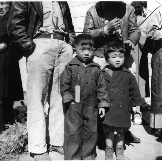 Two small children, a boy and a girl, as they appeared upon arrival at Turlock Assembly Center in California