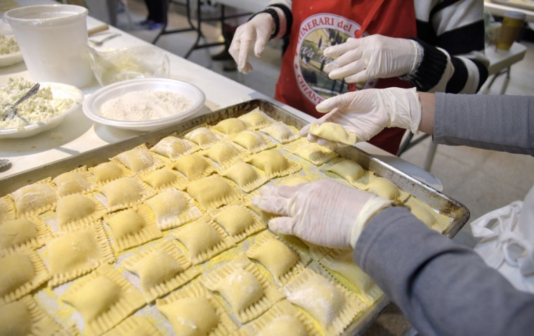 Elisa Wolf counts the ravioli before bringing carrying it to another station; there's 60 to a tray. (Algerina Perna/Baltimore Sun)