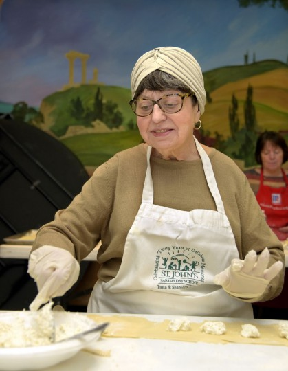 Sharon Esposito Bielski, 74, places ricotta cheese on a strip of dough. (Algerina Perna/Baltimore Sun)