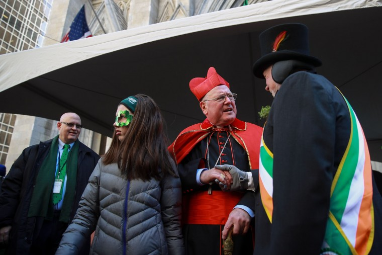 Cardinal Timothy Dolan, Archbishop of New York, greets attendees during the annual St. Patrick's Day parade, March 17, 2017 in New York City. The New York City St. Patrick's Day parade, dating back to 1762, is the world's largest St. Patrick's Day celebration. (Photo by Drew Angerer/Getty Images)