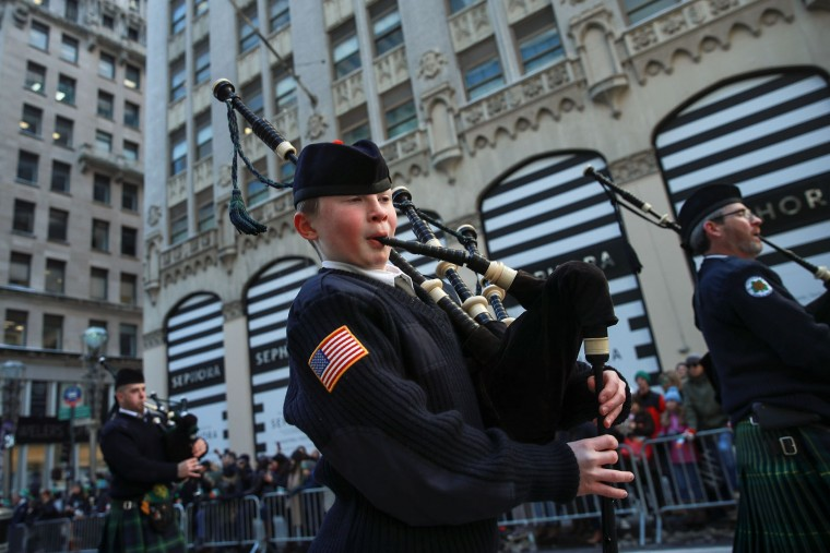 Members of the Xaverian High School Pipe and Drum band (from Brooklyn) march along 5th Avenue during the annual St. Patrick's Day parade, March 17, 2017 in New York City. The New York City St. Patrick's Day parade, dating back to 1762, is the world's largest St. Patrick's Day celebration. (Photo by Drew Angerer/Getty Images)