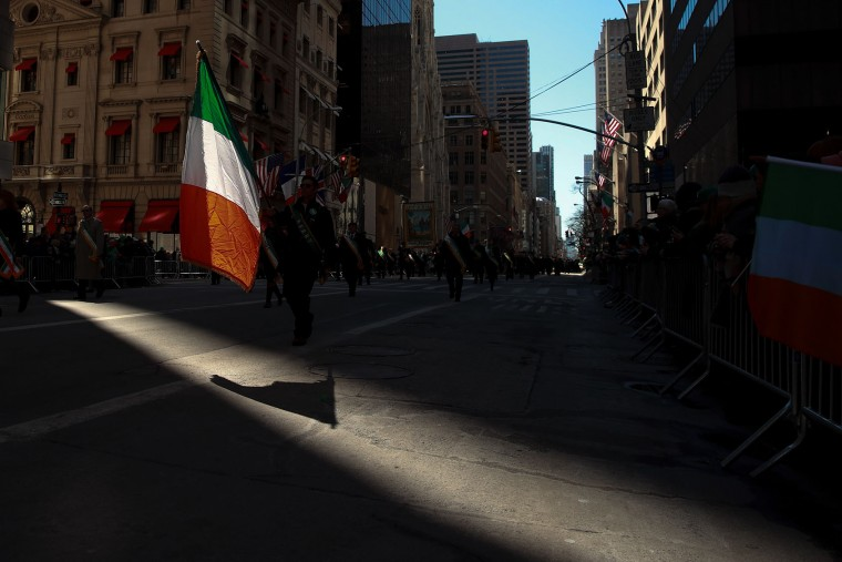 A participant carries a flag of Ireland as he marches along 5th Avenue during the annual St. Patrick's Day parade, March 17, 2017 in New York City. The New York City St. Patrick's Day parade, dating back to 1762, is the world's largest St. Patrick's Day celebration. (Photo by Drew Angerer/Getty Images)