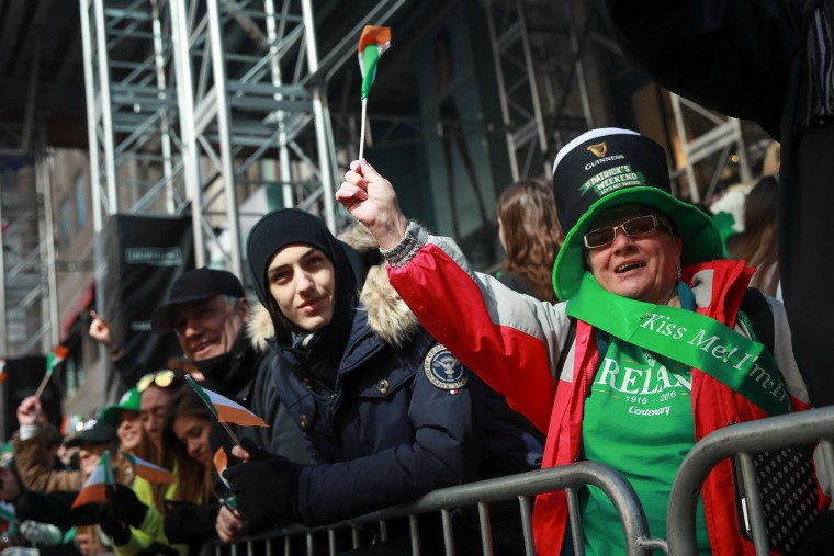 Spectators cheer participants as they march along 5th Avenue during the annual St. Patrick's Day parade, March 17, 2017 in New York City. The New York City St. Patrick's Day parade, dating back to 1762, is the world's largest St. Patrick's Day celebration. (Photo by Drew Angerer/Getty Images)