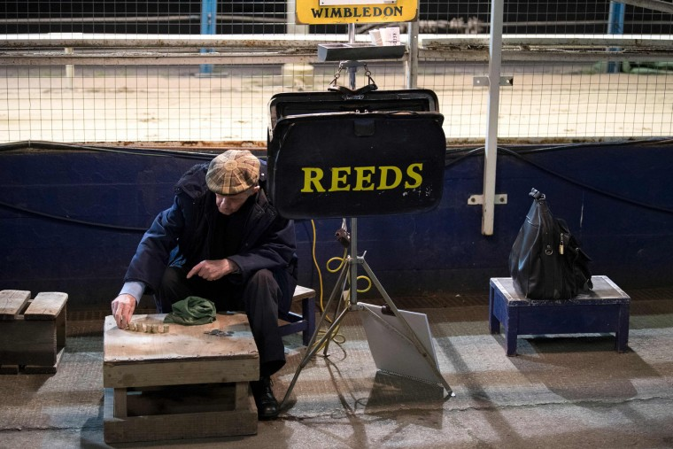 A bookmaker prepares ahead of an evening of greyhound racing in south London on March 18, 2017. March 25 will see the final day of racing at the Wimbledon dog track which will close to be demolished to make way for a new stadium for AFC Wimbledon. The closer of track will mark the end of the once hugely popular working-class sport of greyhound racing in London. (Justin Tallis/AFP/Getty Images)
