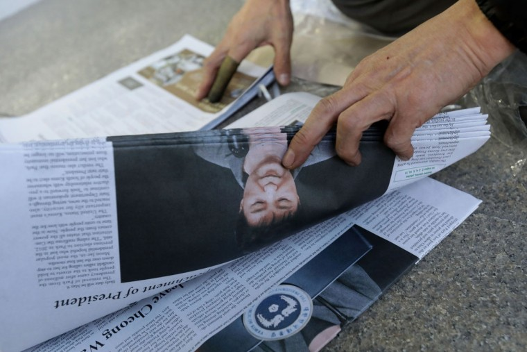 A South Korean man hold up a extra edition newspaper reporting impeached President Park Geun-hye on March 10, 2017 in Seoul, South Korea. The Constitutional Court of South Korea upheld the impeachment of President Park Geun-hye on March 10, 2017. Park will be permanently removed from the South Korean office and the nation will need to hold a presidential election within 60 days. Park had been impeached by parliament in December for allegedly letting her confidante Choi Soon-sil involved in state affairs and colluded to take bribes of millions of dollars from South Korean conglomerates. (Photo by Chung Sung-Jun/Getty Images)