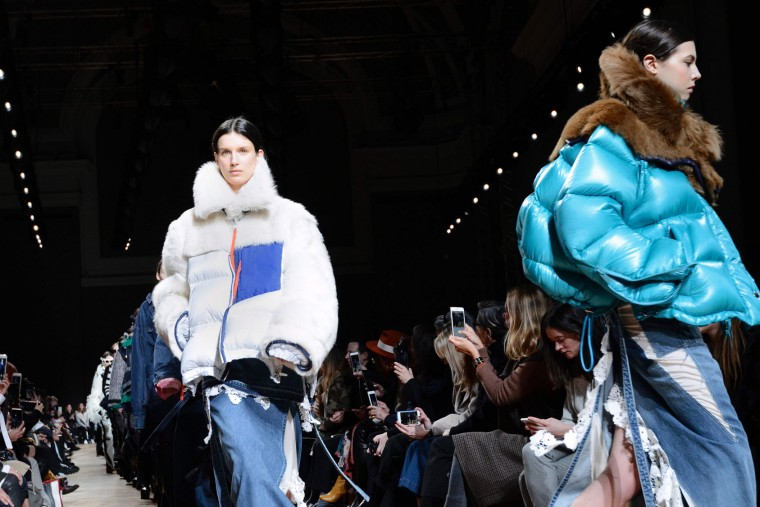 Models present creations by Sacai during the women's Fall-Winter 2017-2018 ready-to-wear collection fashion show, on March 6, 2017 in Paris. (Bertrand Guay/AFP/Getty Images)