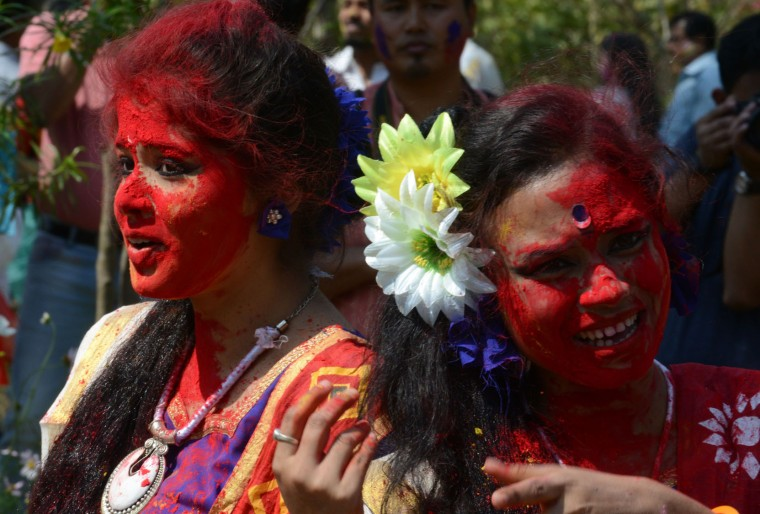 Indian revellers play with colours during celebrations for the Holi festival in Siliguri on March 12,2017. Holi marks the welcoming of spring and is a celebration of the triumph of good over evil, with people chasing each other and playfully splashing colorful paint, powder and water on each other. (Diptendu Dutta/AFP/Getty Images)